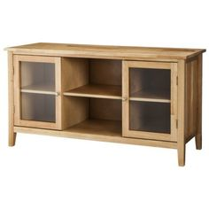 this piece would be perfect on the wall under your wall mount TV for extra storage --Mission TV Stand Media Cabinet - Natural  (Fits TVs upto 55)