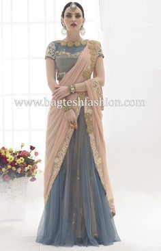 Stylish Peach And Grey Net Lehenga Saree http://www.bagteshfashion.com/women/sarees/lehenga-sarees