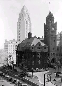 Here we have a great photo taken in downtown Los Angeles in the late 1920s. In the foreground is the majestic old Los Angeles County Courthouse, which we lost in 1936 after it was seriously damaged in the Long Beach earthquake of 1933. Rising in the background is the iconic Los Angeles City Hall, which would have just opened when this shot was taken. Fortunately it's still around so I guess one out of two ain't bad.