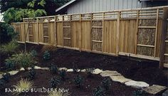 "Fence inspiration: Cedar-Bamboo Fence by Bamboo Builders Northwest ©2005. Vertical cedar boards shoulder bamboo brush panels, topped with bamboo pole ""lattice"" panels."