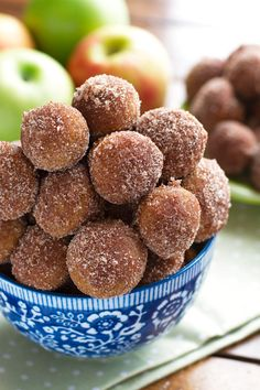 Baked apple cider donut holes are easy to make and are made with no oil and are not fried! These donut holes are baked then rolled in cinnamon sugar!
