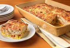 Brunch Strata - Can't find prepared (canned) artichoke salad in your market?  Substitute a combination of marinated artichoke hearts, canned/jarred roasted red pepper strips, and green olives.