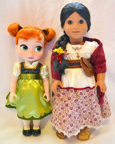 The Doll Grotto: Disney Store Anna and Elsa Toddler Dolls   comparing Anna to one of my American Girl dolls, Josefina.
