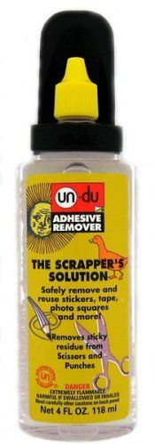 UN-DU Adhesive Remover - 4oz Bottle $9.92  I use this at work all the time!!!  takes gunk off of scissors, takes off stickers and goo without harming any surface!
