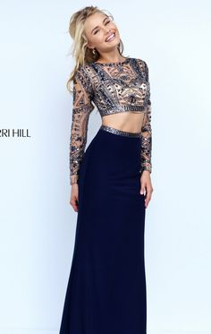 Look phenomenal in this two-piece set gown, Sherri Hill 50097. Intricate…