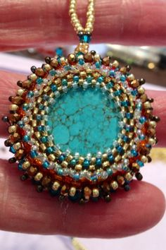 Beading around a gem stone. Designed and handcrafted by Pam Keith.