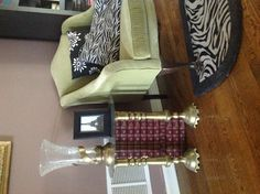 Antique encyclopedias and candlesticks make a side table