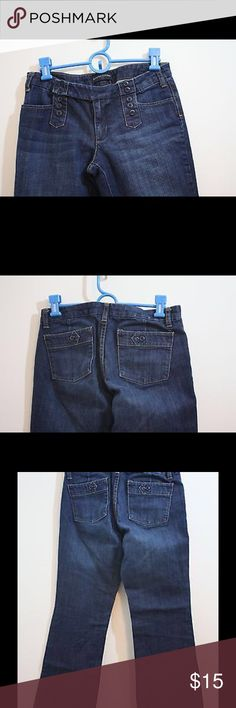 "Banana Republic Stretch Jeans Boot Cut Size 4 Pre-Owned Banana Republic Size 4 Stretch Jeans Boot Cut Dark Wash UNIQUE Button Waist Band, Front and Back Pockets. Item is free of tears, steins and major fabric flaws. See all pictures for details.  Measurements:  Waist circumference: 30""  Inseam: 28""  Leg Opening: 19"" (9.5 seam to seam)  Materials:  99% cotton  1% spandex Banana Republic Jeans Boot Cut"