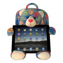 """Did you hand your old iPad down to your kids? The Tablet Teddy Bear from Dean Designs can help protect their new """"toy."""" The bears have their own tablet-size, padded backpacks and they can hold an iPad or other tablet in their flexible arms. The bears have non-skid midsections and, er, hindquarters, thus keeping the iPad from moving as a child pokes and swipes at it. CLICK THE PIC for more info."""