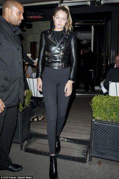 Gigi Hadid wearing Rag & Bone Circle Crossbody Bag, Versace Biker Jacket, American Apparel Knitted Classic Crop Top and Lululemon Wunder Under Pants