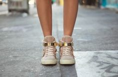 flesh-toned sneakers with a touch of pink and gold hardware is street-femme.