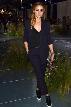 Olivia Palermo wearing Tibi Cami in Black, Kurt Geiger Labelle Slip-on Satin Trainers and Paul Smith Black Milano Trousers