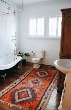 Taurus astrology home decor guide | Bohemian bathroom with Persian rug | Girlfriend is Better