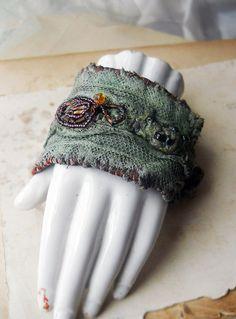 SALE - Beaded Fabric Cuff Bracelet - Green Cuff - Muddy Mint Bracelet - Purple and Gold Glass Beads - Wrist Curtains - Assemblage Cuff