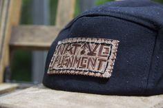 five panel close up. hand burned leather.