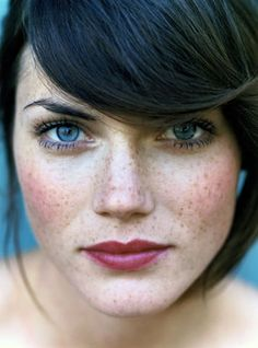 freckles. blue eyes. brown hair.