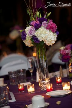 high and low centerpieces purple | the reception decor included a mix of high and low centerpieces