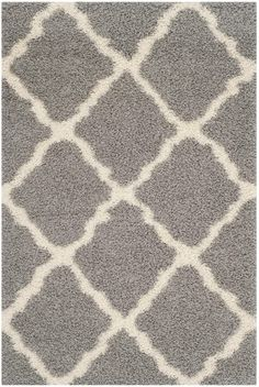 SGD257G DALLAS SHAG Rug from Dallas Shag collection.  The lush pile and Diamond shaped tile motifs of the Dallas Shag Collection will add a sense of flowing dimension and balance to contemporary decor. Power-loomed using high-quality synthetic fibers for a durable, easy-care shag carpet that will stand tall in high-traffic areas of the home or casual business office.