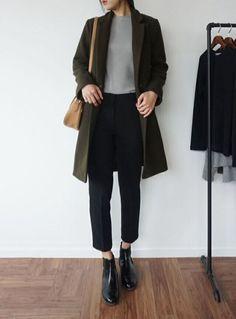 grey shirt, black bottoms, black boots, green coat