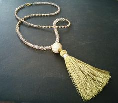 A personal favorite from my Etsy shop https://www.etsy.com/ca/listing/516547043/tassel-necklace-long-gold-necklace-pave