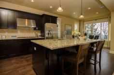 What do you think of this open kitchen from Lennar Portland? Do you <3 the countertop, floors or everything!?