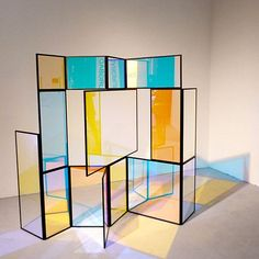 """This folding screen entitled """"And A And Be And Not"""" by Berlin-based designer Camilla Richter is made from different color transparent sections, which change color according to the light and where you're standing when you look at it. Part of [D3] Design Talents at imm cologne.:"""