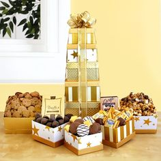 Ultimate Golden Star Gift :Go for the Gold. Show your appreciation by sending this tower of golden gourmet sweets. No one will be able to resist the chocolate.