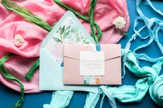 Jupiter and Juno Wedding Invitation Suite: ALYSSA, soft blue and pink with watercolor envelope liner and belly band, soft pink letterpress printing, complete with pocket folder to hold all of your cards, a perfect spring statement invitation