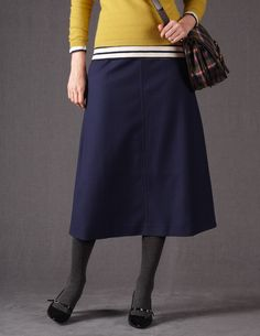 I had a brown wool skirt in college about this length and shape that I loved. it's nice to see calf-length skirts make a comeback.