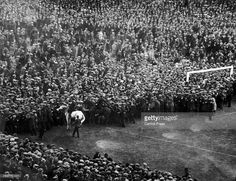 Mounted policemen control the crowds overflowing onto the pitch before the FA Cup Final between West Ham United and Bolton Wanderers at Wembley Stadium. The first final to be held at Wembley, the game became known as the 'White Horse Final' for the action