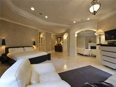 All white with touches of black bedroom - 2705 Island Ledge Cv, Island On Westlake, Austin TX #bedrooms #austinrealestate #homedecor