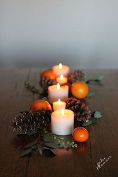 If an elaborate Thanksgiving table isn't exactly your cup of tea, take a cue from blogger Julie Blanner. In just five minutes, the blogger created a gorgeous and simple tablescape by arranging pillar candles, pinecones, clementines, and floral stems on her table.  See more at Coordinately Yours.