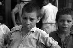 Children begging for pennies in the market in Rio Piedras, Puerto Rico; photo by Jack Delano | pinned by haw-creek.com