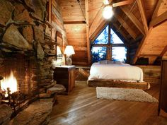 Cozy Cabin Bedroom - I would like to cuddle up on that bed and watch the flames flicker. Sigh.