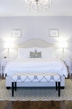 Pale blue bedroom, upholstered headboard and chandelier