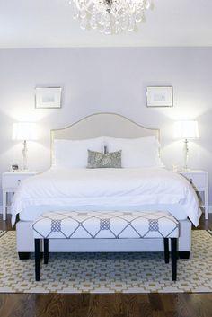 Pale blue bedroom, upholstered headboard and chandelier