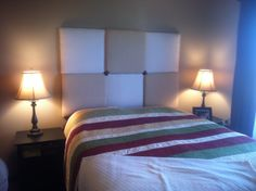 Finally finished my head board project! Love it! One fabric is actually an old bed sheet!!