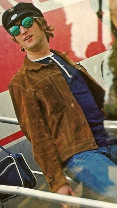 """John Lennon wearing his """"Rubber Soul"""" jacket. This is the brown suede jacket worn most notably by John on the cover photograph of the Rubber Soul album. Circa 1965."""