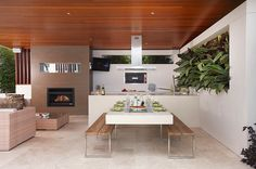 open-space-decor-with-kitchen-countertop-extension - Home Decorating Trends - Homedit Modern Outdoor Kitchen, Build Outdoor Kitchen, Outdoor Rooms, Outdoor Dining, Outdoor Kitchens, Indoor Outdoor, Outdoor Furniture, Outdoor Fire, Table With Bench Seat