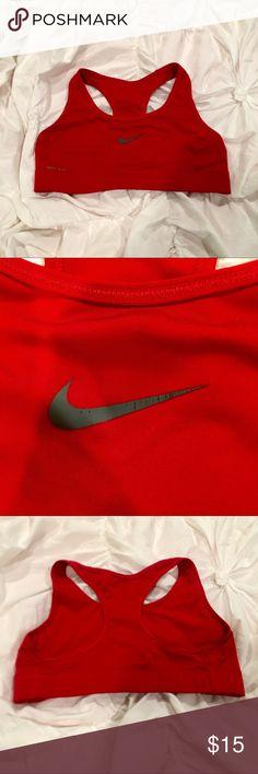 Red Nike Sports Bra Nike Dri-Fit Sports Bra in red. Worn but still has a lot of life to it ! Great condition still. Nike Intimates & Sleepwear Bras