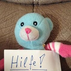 FOUND in HAMBURG, GERMANY. Freddy Hamburgm the light blue & pink striped teddy bear seen here, was found in the Hamburg Germany. He's so clever, he even set up his own facebook page to find his family: https://www.facebook.com/pages/Freddy-Hamburg/1407960212749398