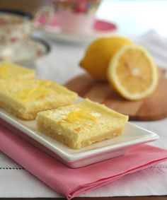 Low Carb Lemon Cheesecake Bars - Bright, creamy lemon cheesecake filling baked on a tender shortbread crust. Sugar-free and gluten-free. Total NET CARBS = 2.5 g. per serving