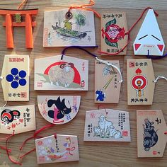 A collection of ema, or prayer tablets, from various temples and shrines in Japan. Photo by @hanyayanagihara #kyoto #tokyo #athomeintheworld