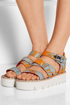 Why we love it: Forget your flip-flops; this season's reigning sandal is the flatform — the boosted style that will help you channel this season's '70s trend from head to toe. Pair your playful shoes with a fringe skirt or wide-leg pants, and finish it off with a breezy bohemian top. MSGM Leather-Trimmed Canvas Sandals ($385)