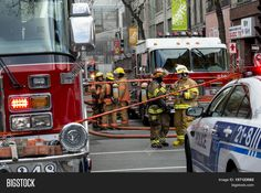 Montreal, Canada, Nov 17 2016 : Montreal Firefighters and Police in action on the scene of a major fire in China Town. Scene on the street in Montreal where North America's first movie theatre a Heritage Building and Historic site burns to the ground
