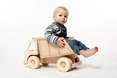 robur... I love wooden toys and this one would be perfect for my little boy...maybe for his first b-day? :)