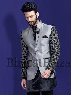 Luxurious black color short kurta planed on satin comes with matching bottom is awesome. Item Code: SAKP4020  http://www.bharatplaza.com/new-arrivals/kurta-pyjamas.html