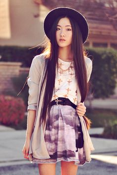 Cute layered outfit. Definitely one to keep in mind when attempting to mix prints.