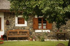 with stone wall, wood bench & jalousie . Rural House, My House, Cottage Homes, Cottage Style, Chalet Style, Village Houses, Traditional House, House Tours, Home Remodeling