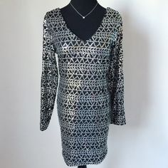 """Sequin Dress Sequin Dress with silver geometric design.  Double vneck and cold shoulder slits.  Pull on style, no zipper.  Great for holiday parties!  Pre-loved but in excellent condition.  No holes, stains or missing sequins.  Measurements laying flat: Armpit to armpit: 17"""" Waist (across): 15"""" Hips: 16.5"""" Top of shoulder to bottom hem: 32.5"""" Sleeve length: 24"""" As U Wish Dresses Long Sleeve"""